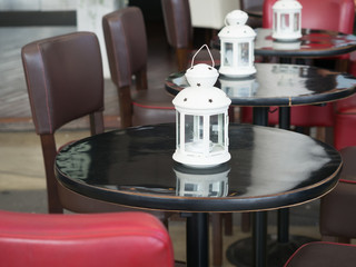table and chairs decorated with white lantern