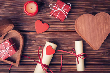 Valentines day background with gift boxes, candle, rolled paper