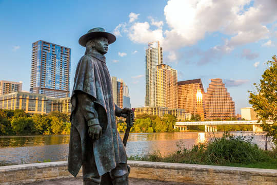 Stevie Ray Vaughan statue in front of downtown Austin and the Co
