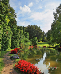 Pond and red flower beds