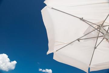 white umbrella blue sky