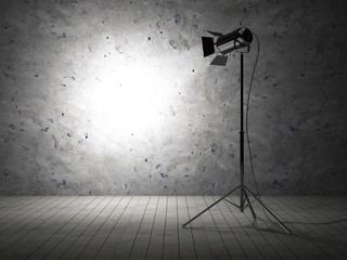 Empty Grunge Photo Studio with Concrete Wall and Spotlight