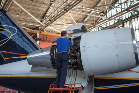 Business jet airplane stays in hangar..