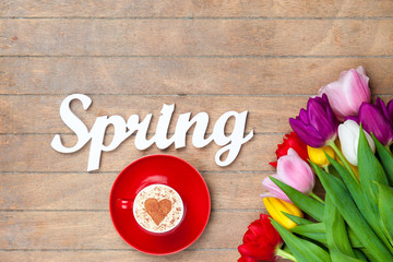 Cappuccino and word Spring near flowers