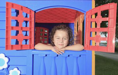 little girl play in a little house