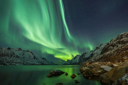Aurora Borealis reflected between two fjords in Tromsø