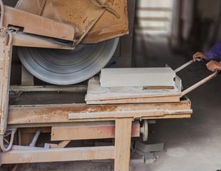 Worker with machine cutting blocks