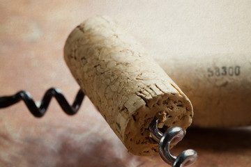 Two corkscrew with wine corks. Macro view. Closeup. Soft focus.