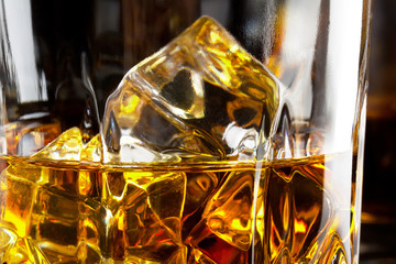 Fragment of a glass of whiskey with ice