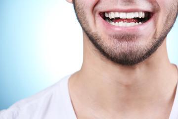 Smiling young man after visit dentist
