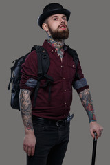 Male with tattooes holding cane