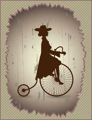 Beautiful lady in a dress and hat riding a vintage bicycle