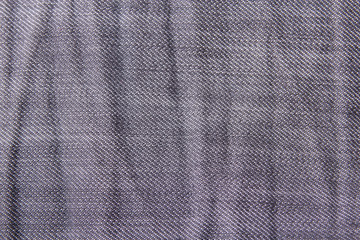 texture background - close up of wrinkled jeans material