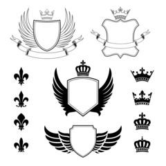 Set of winged shields, crowns and fleur de lis design elements