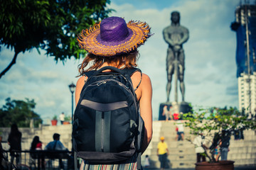 Woman looking at statue in manila