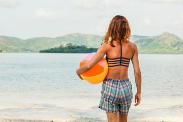 Woman with beach ball on the beach