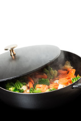 Frying vegies in skillet vertical copy space