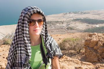 Young woman wearing kafia portrait.