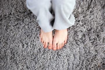 Closeup image of female legs on the carpet