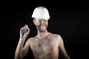 happy  miner shows a silver nugget