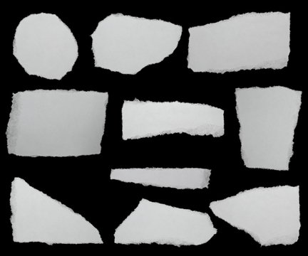 set paper scraps isolated on black background