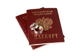 Isolated pair of wedding rings and passports