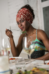 African woman eating at home