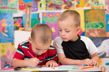 Two brothers enjoy drawing