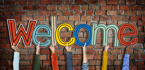 Group of Hands Holding Word Welcome Wall mural