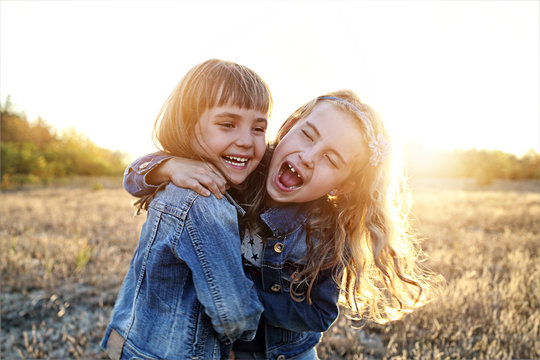 Two young girls have fun outside
