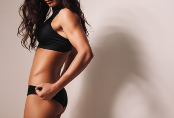 Fitness female model in sportswear