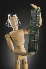 Wooden figure holding computer part