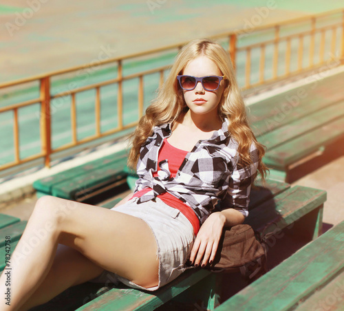ca755a3231 Pretty sexy hipster blonde woman in sunglasses posing outdoors ...