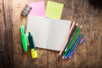 two blank colorful sticky notes , notebook ,pencil ,highlighter