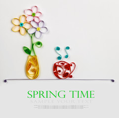 colorful flowers in a vase and a hot cup of quilling to spring t