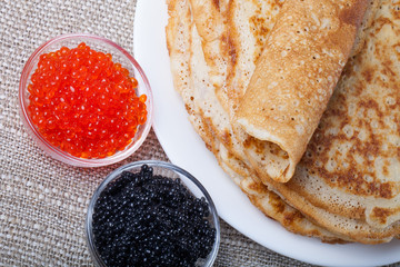 Russian pancakes - blini with red and black caviar