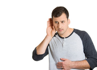 man with hand behind ear listening closely carefully