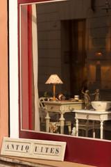 Window display of antiques shop in Verona, Italy