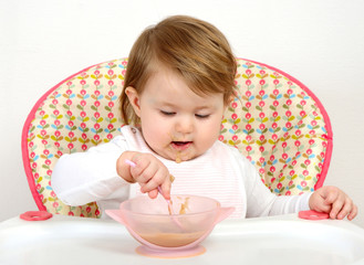 portrait of cute baby eating