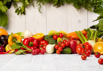 Fruit and vegetable borders on wood table