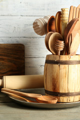 Wooden utensils on wooden table and color planks