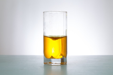 glass of yellow liquid