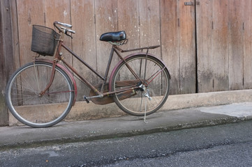 old bicycle on wood background