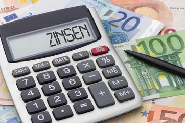 Fotomurales - Taschenrechner mit Geldscheinen - Zinsen