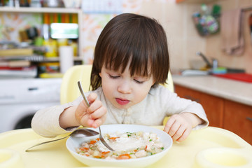 Lovely 2 years child eats cabbage soup
