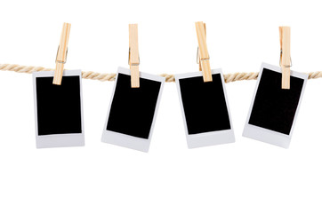 instant photographs hanging on a rope clothesline