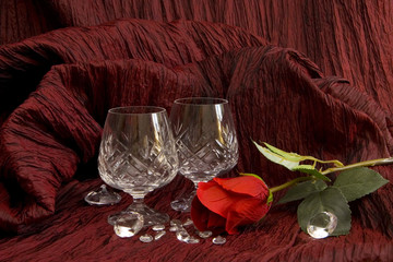 Romantic setting with couple of crystall glasses
