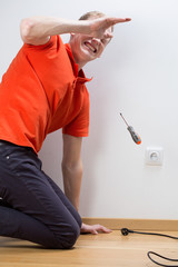 Electrocuted man repairing socket
