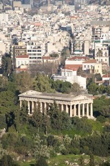 Temple of Hephaistos in park beside suburbs