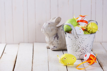 Symbols of Easter - easter rabbit and eggs.